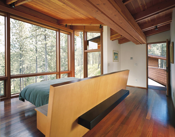 Ridge House Located in the Middle of Conifer Forest