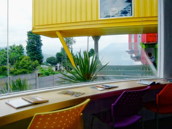 Colorful And Eye Catching Library Built From Recycled Shipping Containers