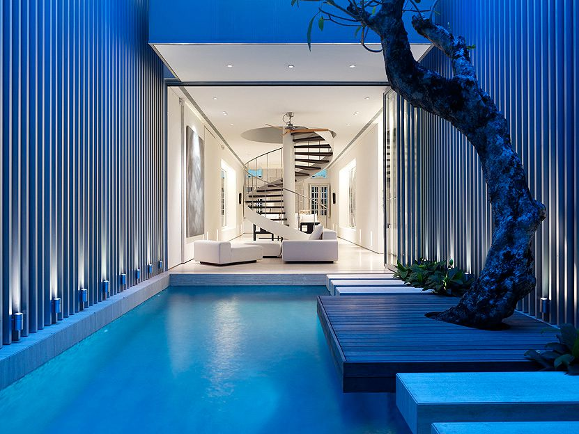 18 amazingly beautiful indoor pool designs that will for Beautiful house designs with swimming pool