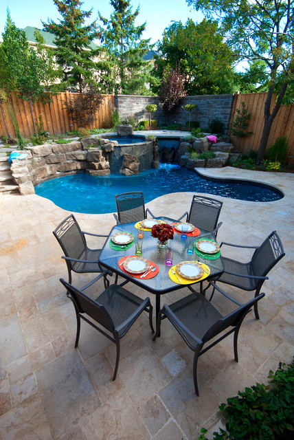 16 Sensational Backyard Pool Designs You Must See on stone patios and pools, backyard kitchens and pools, concrete patios and pools, backyard hot tubs and pools, backyard waterfalls and pools, backyard pool houses and pools, backyard arbors and pools, fireplaces and pools, tropical patios and pools,