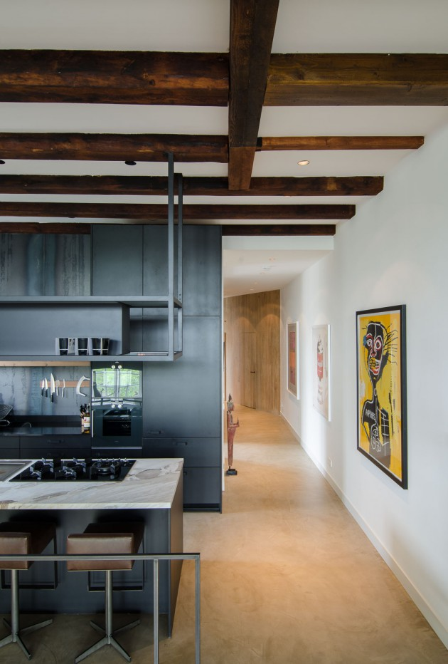 An old sugar refinery on an Amsterdam canal, converted into contemporary loft by architect Standard Studio