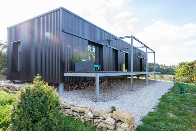 17 outstanding industrial home exterior designs you 39 ll be for Industrial home plans