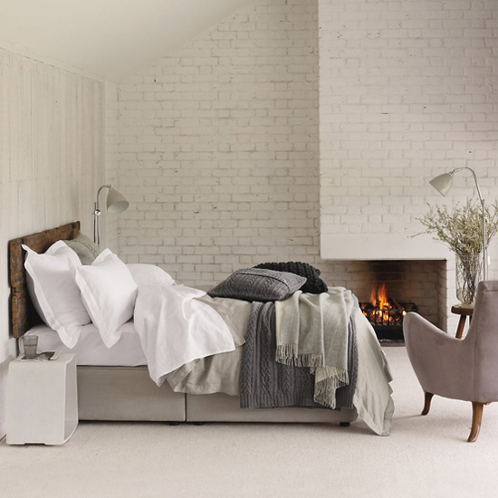 Enter Rustic In Your Bedroom: Wall Of White Bricks For Warm Ambience