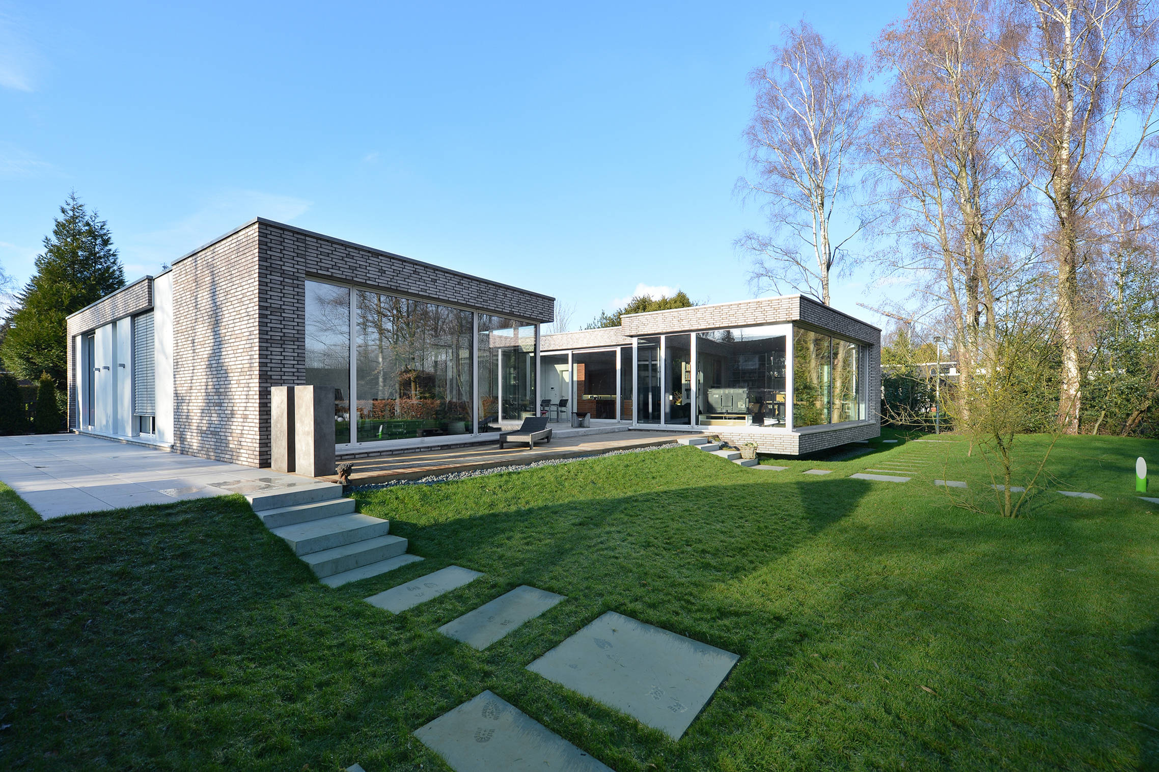 16 Delightful Modern Landscape Ideas That Will Update Your ... on Contemporary Backyard Landscaping Ideas id=59127