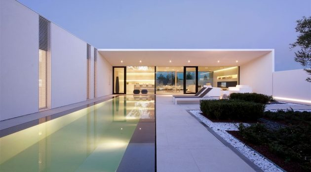 The Jesolo Lido Pool Villa by JM Architecture in Italy