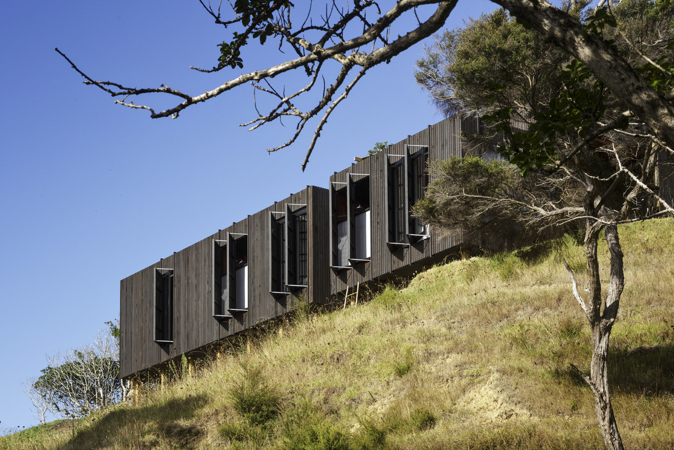 castle rock house by herbst architects in whangarei new