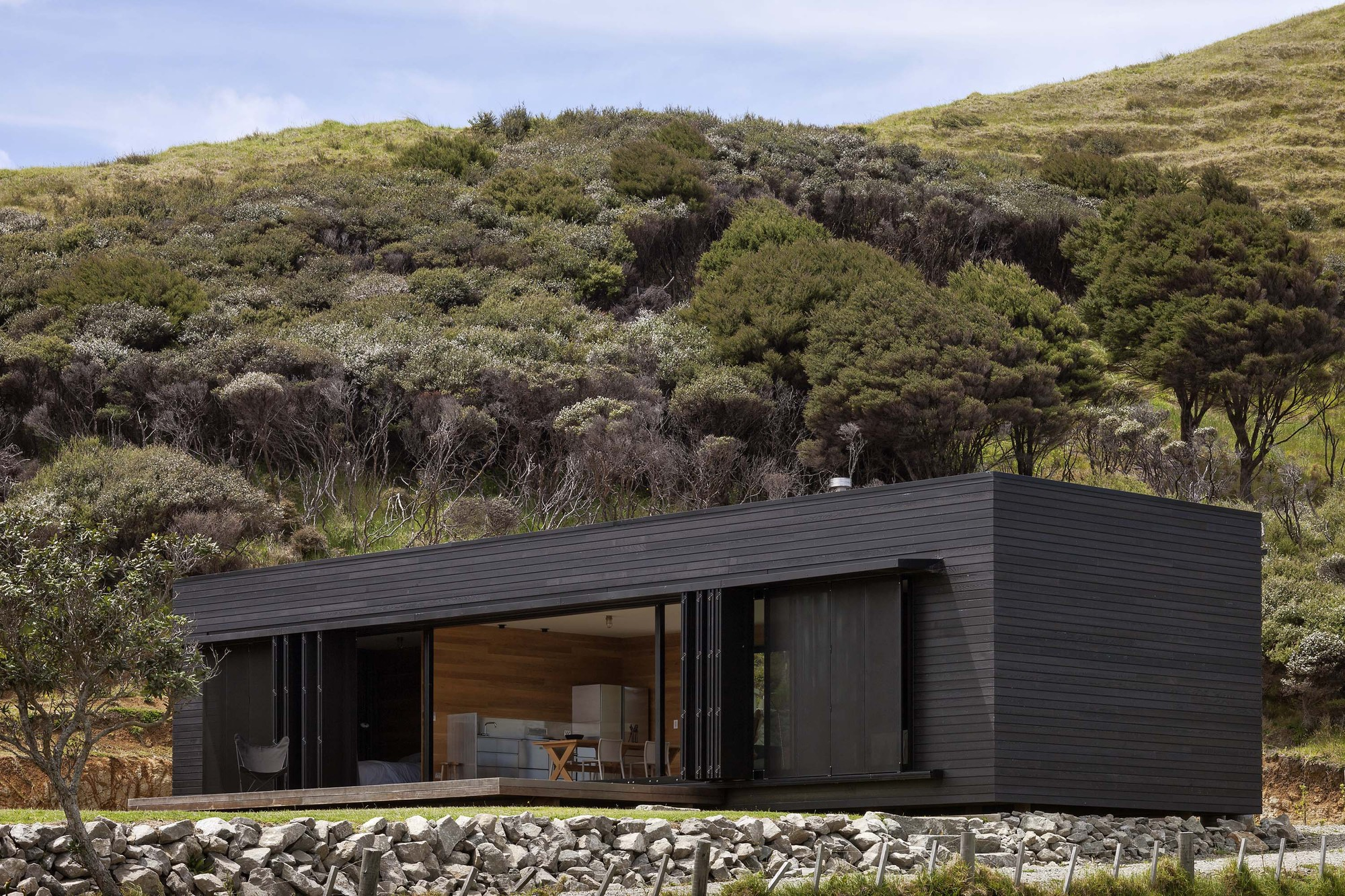 Storm cottage by fearon hay architects in great barrier for Minimalist house plans nz