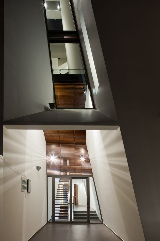 Folding Wall House by Nha Dan Architect in Ho Chi Minh, Vietnam