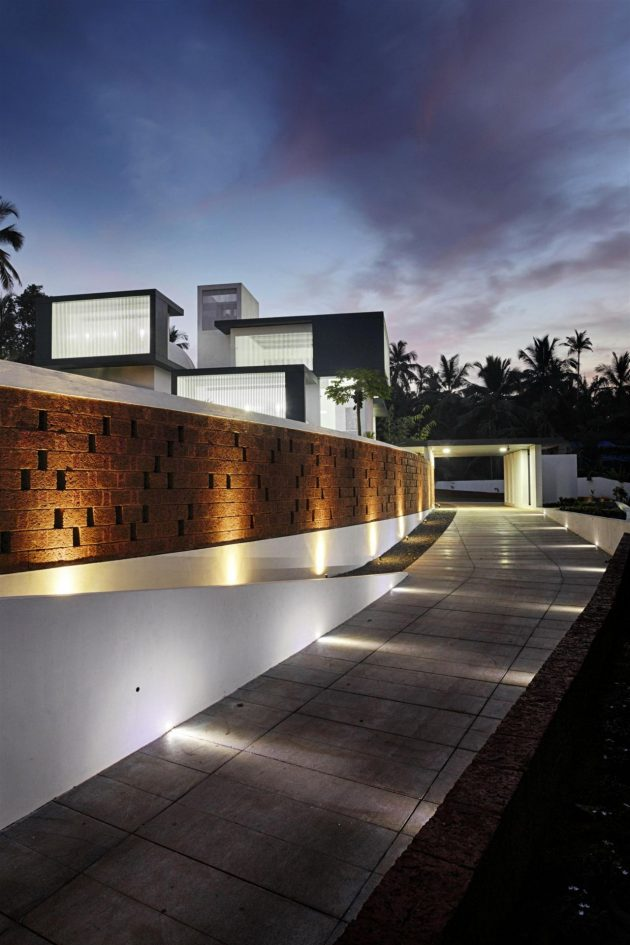 The Running Wall Residence by LIJO RENY Architects in Thalassery, India