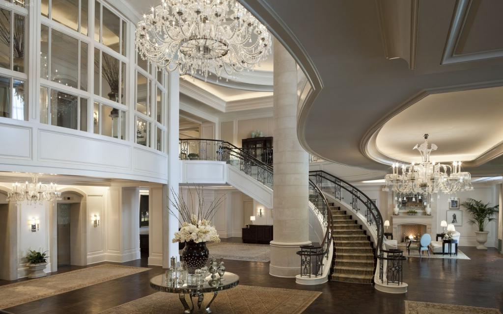 Wyspa Sycylijska Luxury-and-elegant-home-interior-design-with-chandelier-also-staircase-plus-dark-color-floor-room-and-round-table