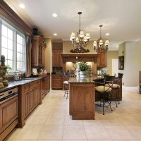 Large kitchen in wood cabinetry with island
