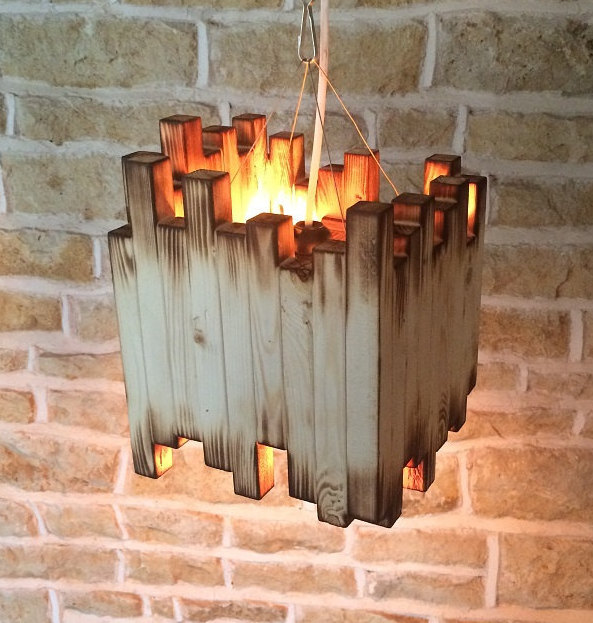 Handmade ceiling light from burnt wood