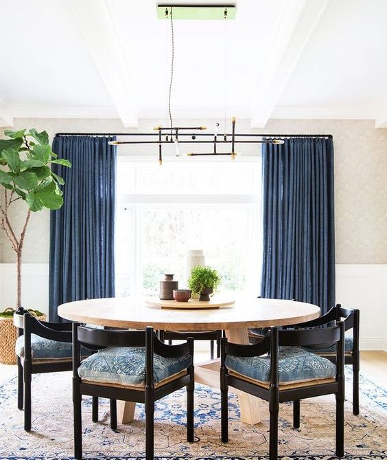 16 Captivating Interiors With Blue Curtains For Dramatic Ambience