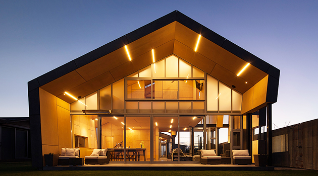 Fe3O4 House by Crosson Architects in Taiharuru, New Zealand
