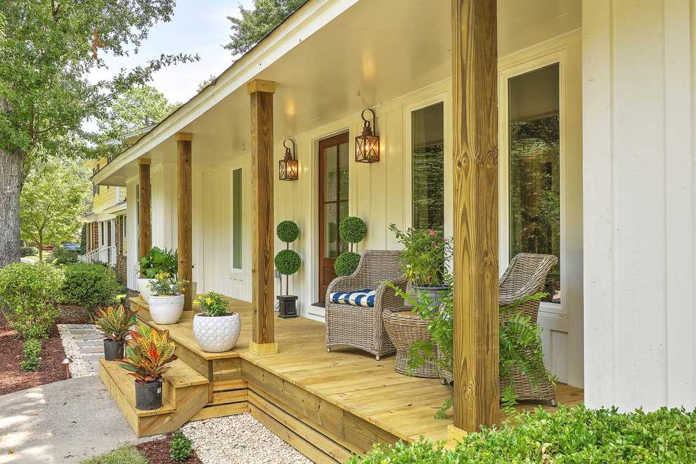 15 Irresistible Farmhouse Porch Designs You're Going To Drool Over