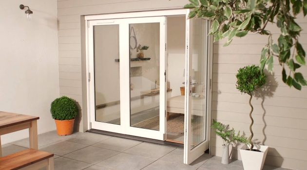 Folding patio doors create a seamless transition into the world
