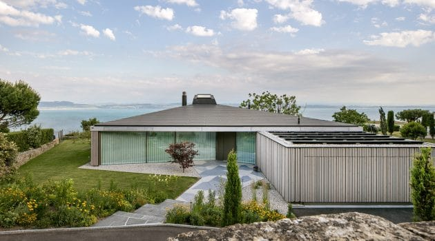House in Hauterive, Switzerland by Bauzeit Architekten