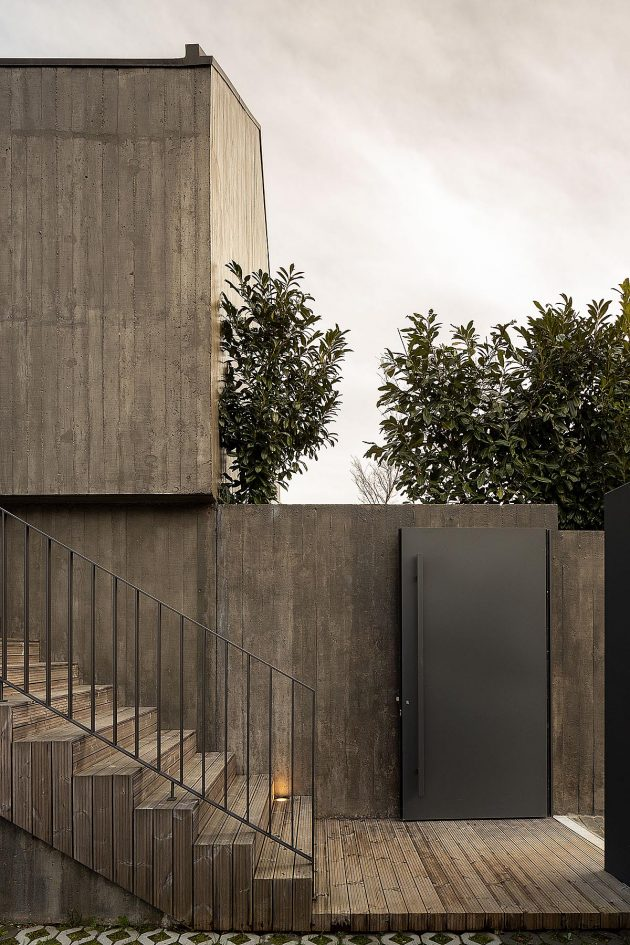 Opening the timber screens reveals a concrete House CG in Portugal