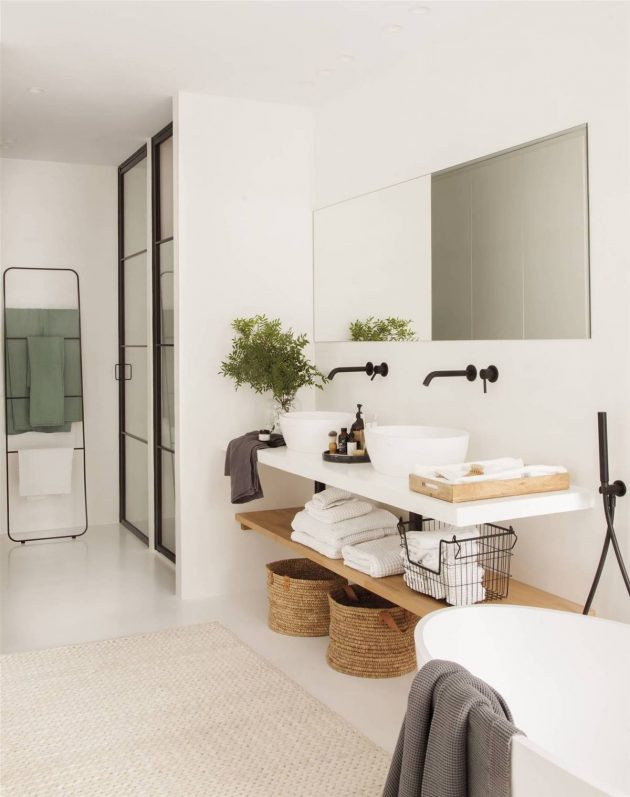An En-Suite Bedroom with a Large White Bathroom