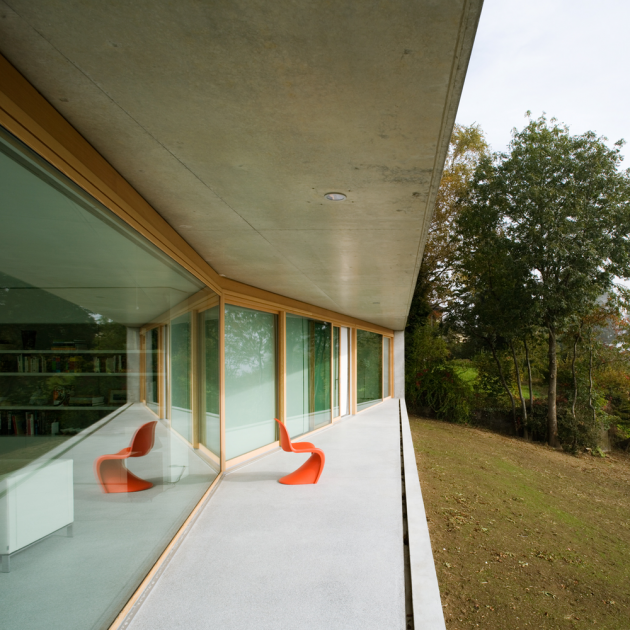 Gauthier House by Bauzeit Architekten in Evilard, Switzerland