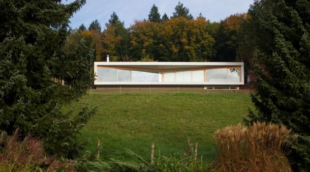 Gauthier House by Bauzeit Architekten in Evilard, Switzerland