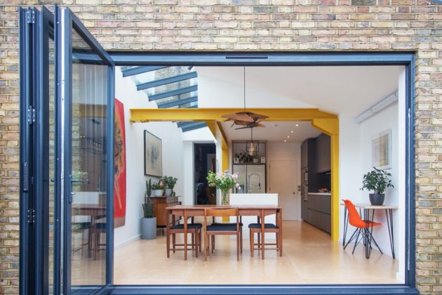 Yellow Steel House Extension by CVC Architecture in North London, UK