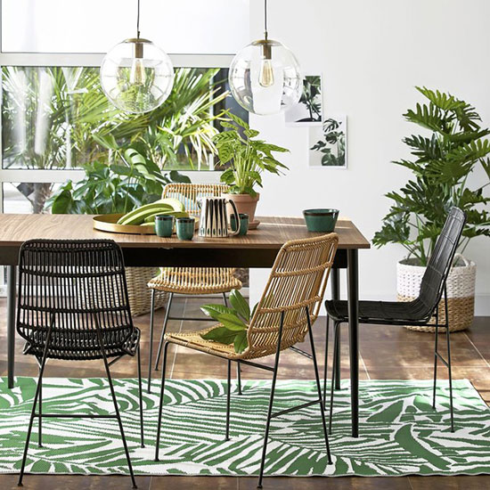 Opting For A Rattan Chair Always Brings An Exotic Touch In Home Decor